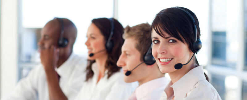 Smiling Business People with Headsets